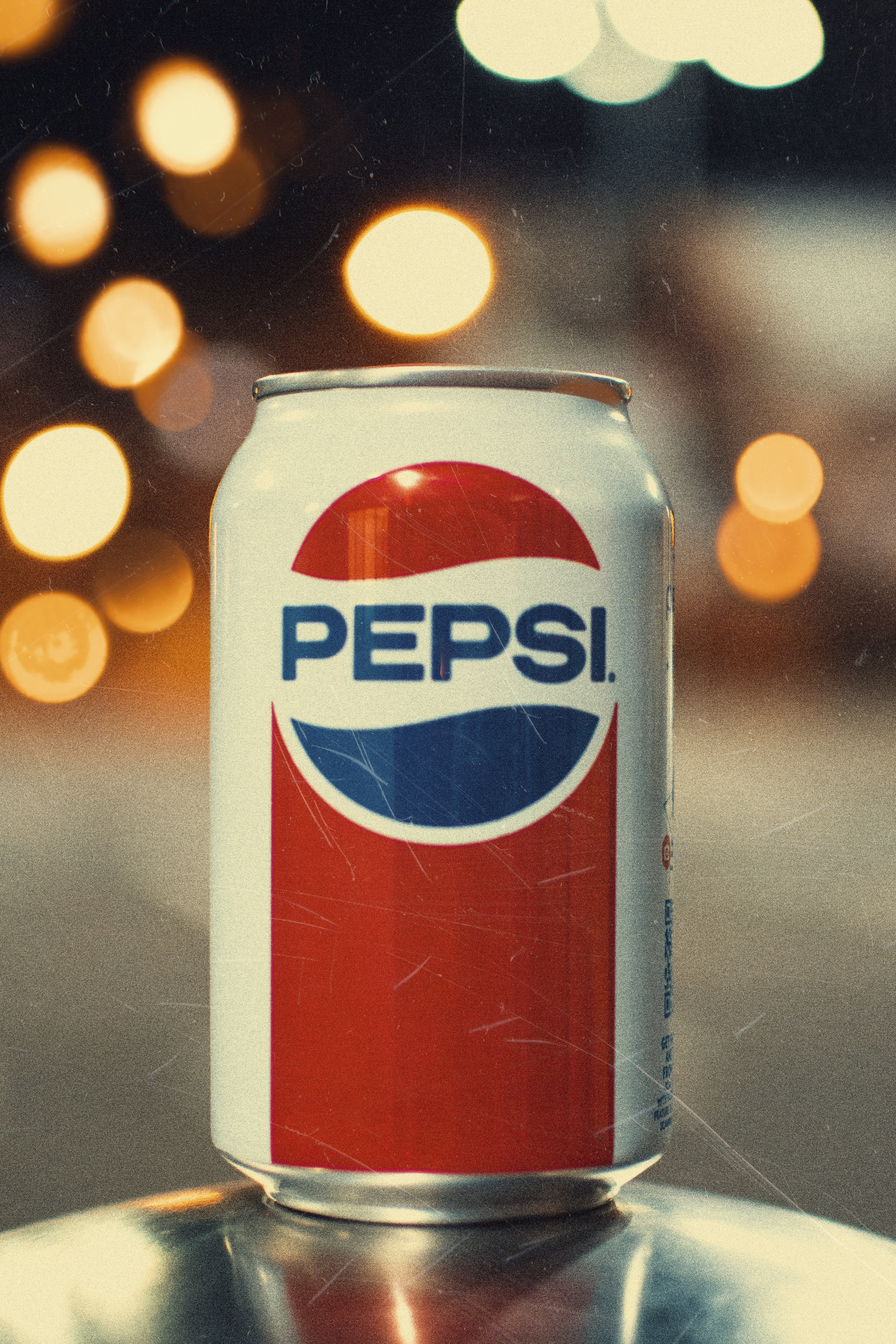 Pepsi can on gray surface