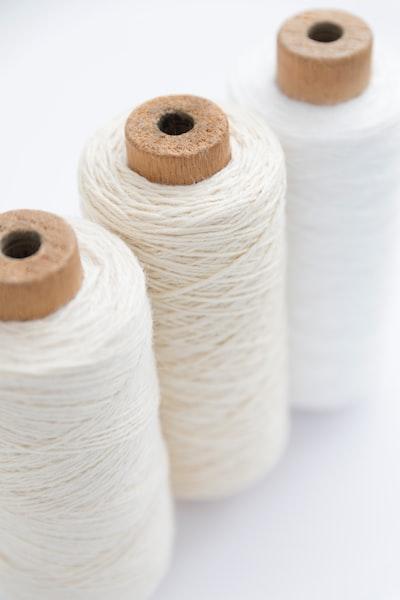 three spools of white threads