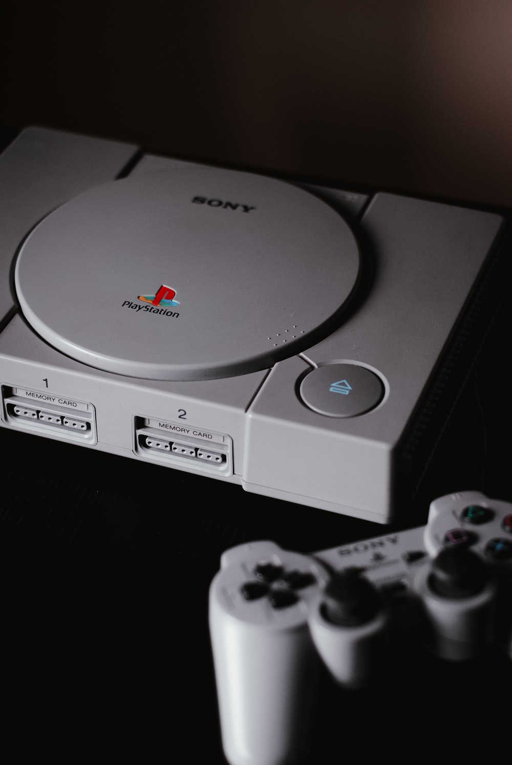 photo of closed Sony PS1 with DualShock 1