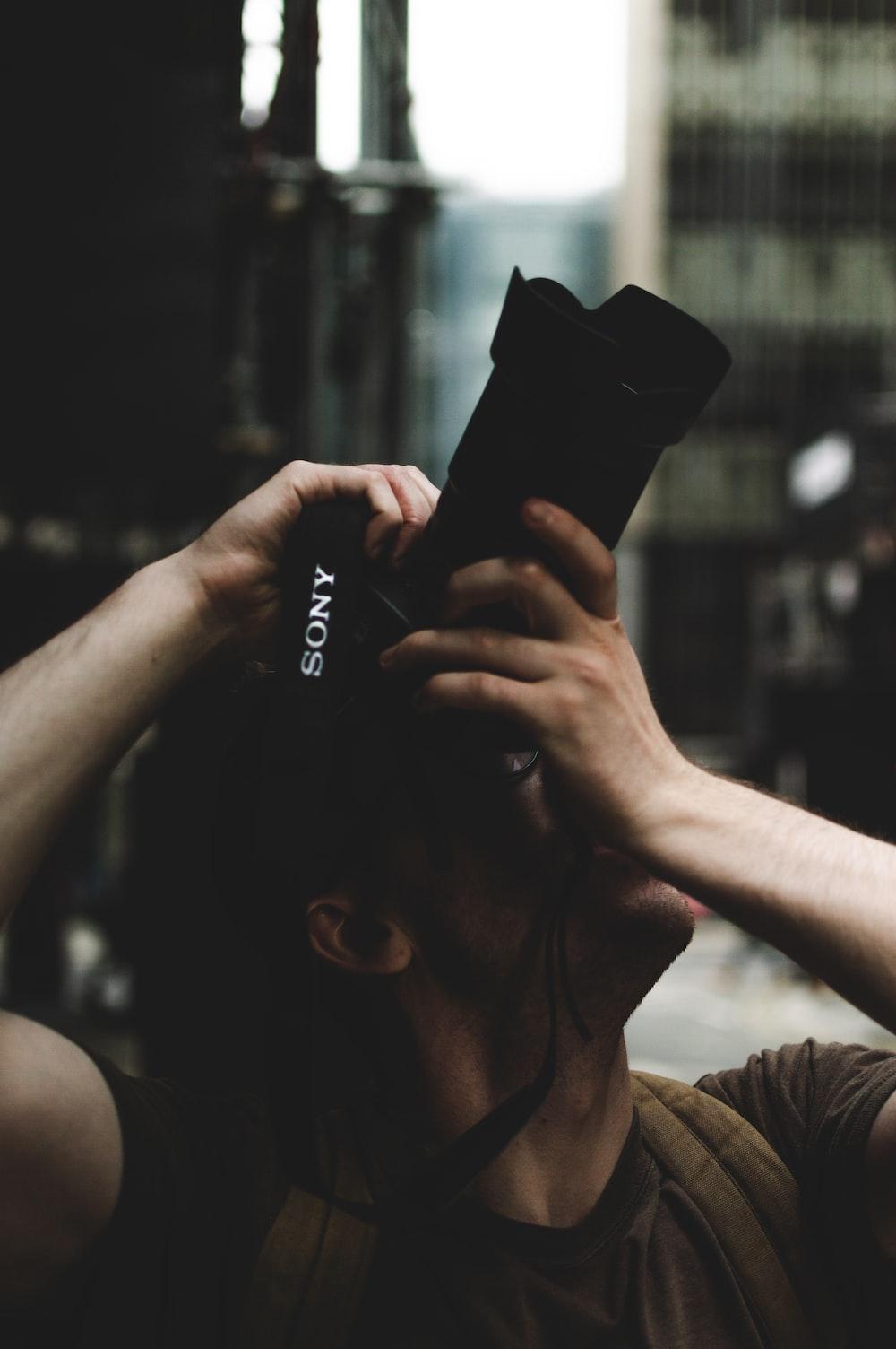 person using Sony DSLR camera