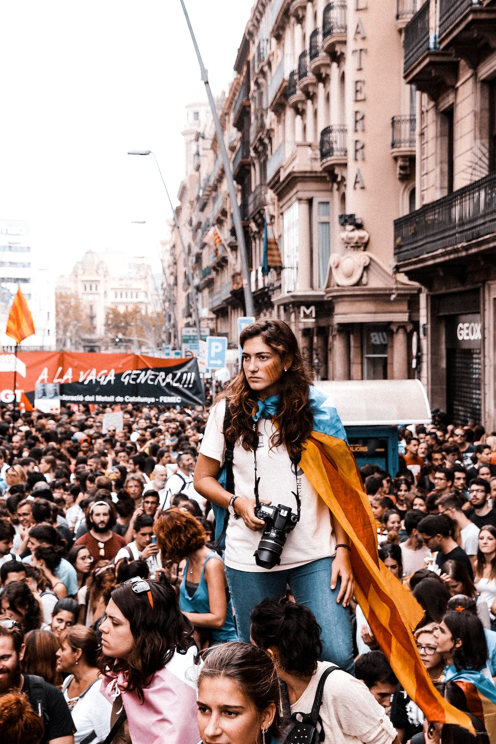 woman standing on crowd of people