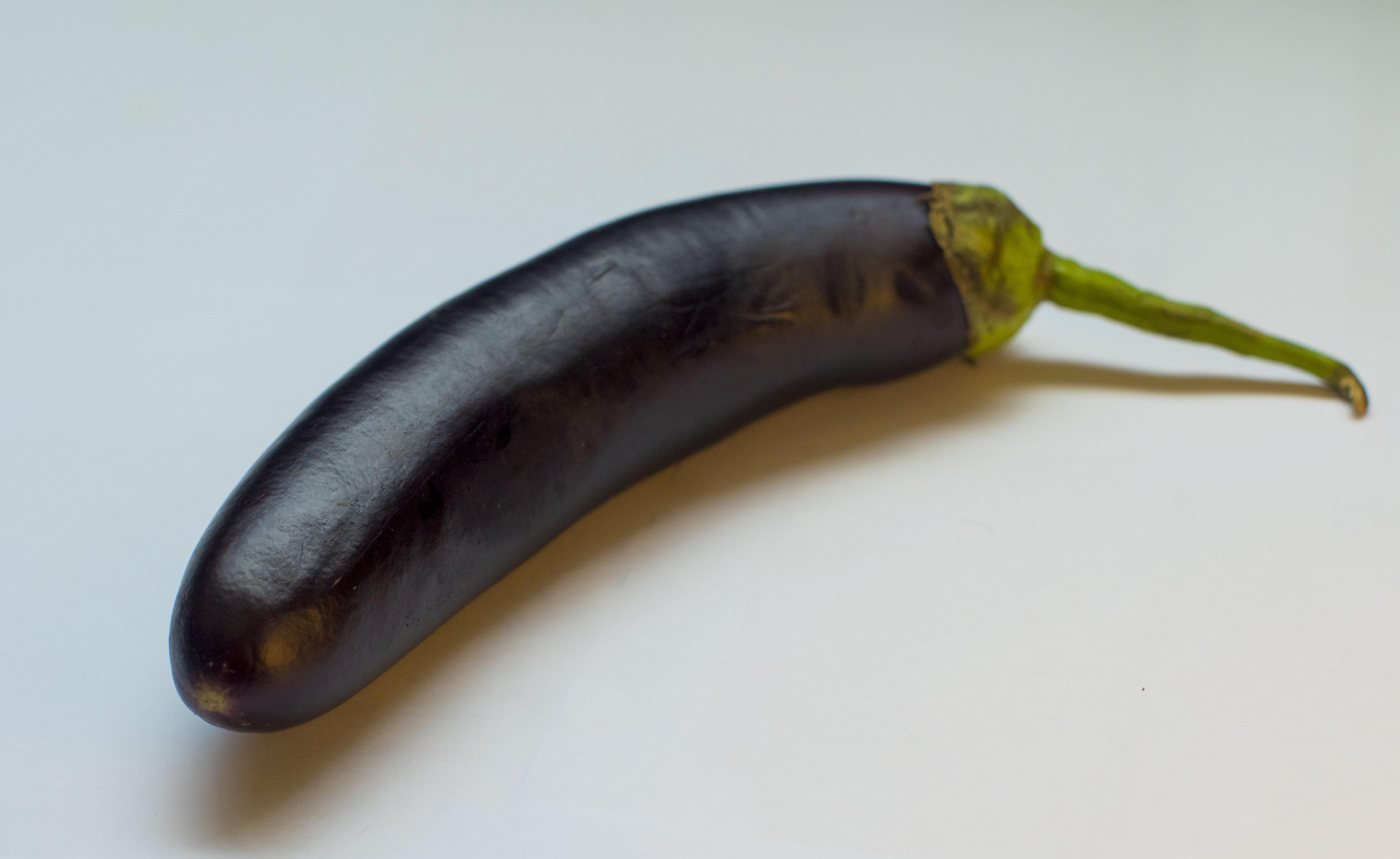 purple eggplant on white surface