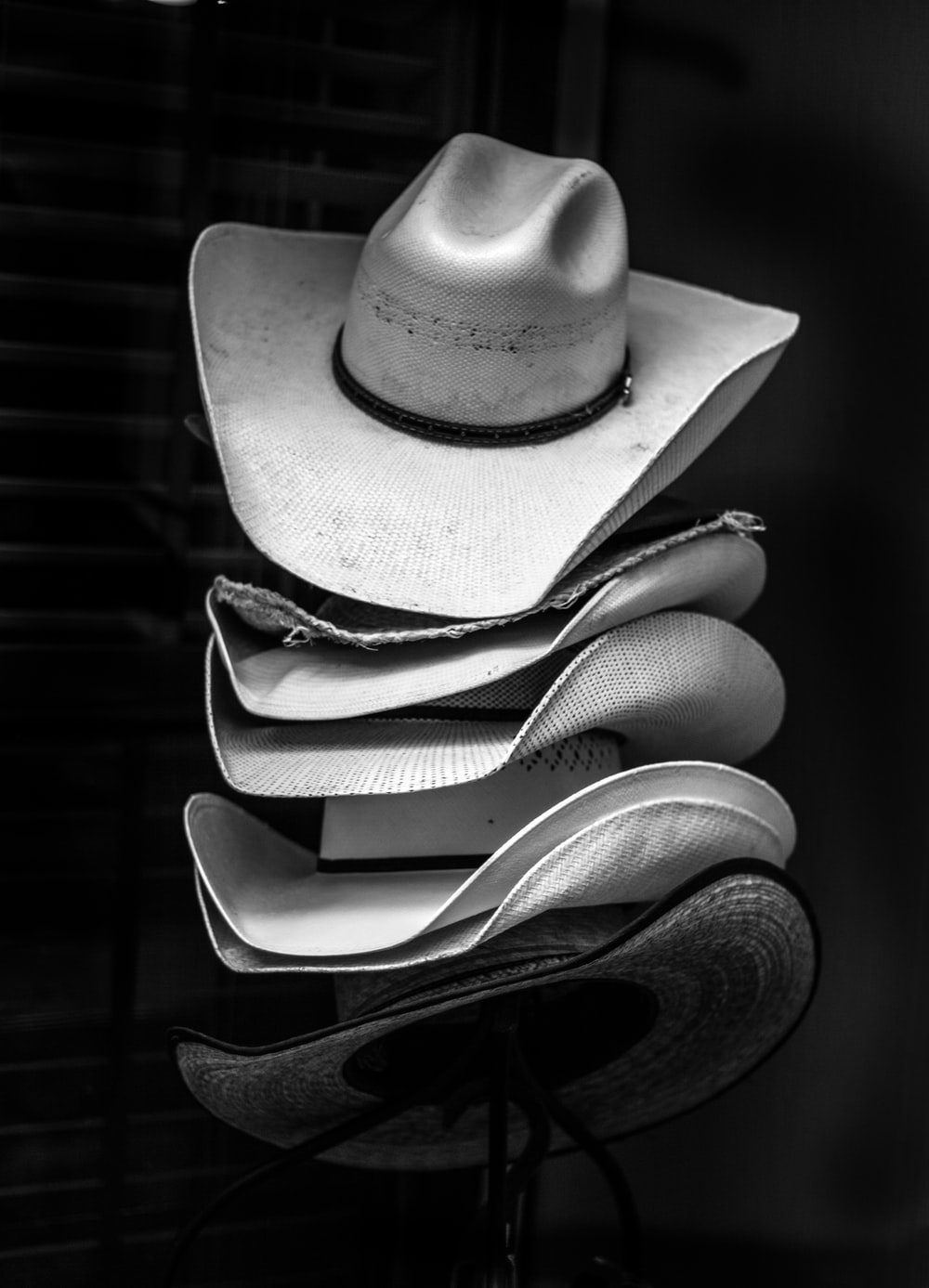 grayscale photography of piled cowboy hats