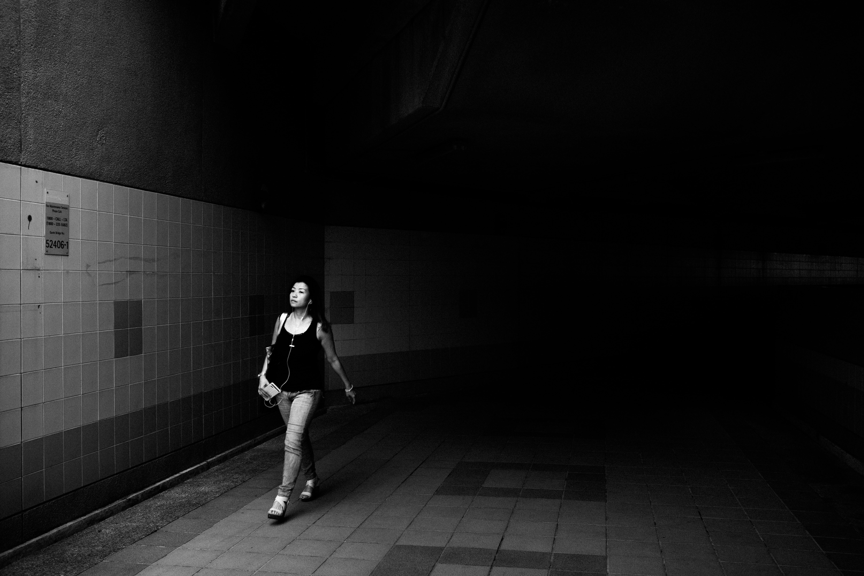 grayscale photo of girl wearing tank top