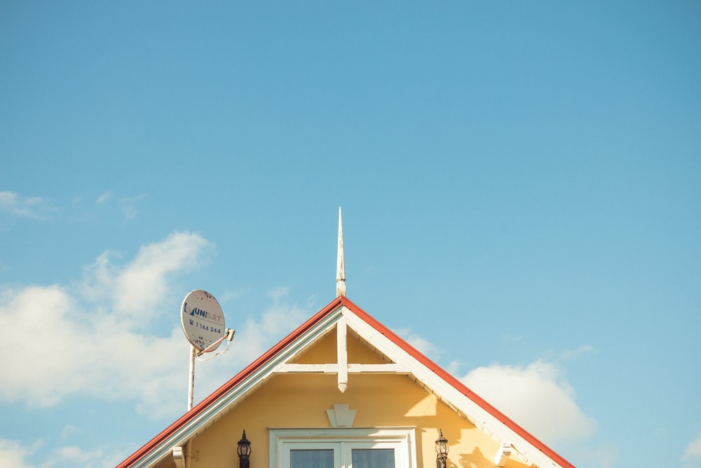 yellow house with parabolic dish
