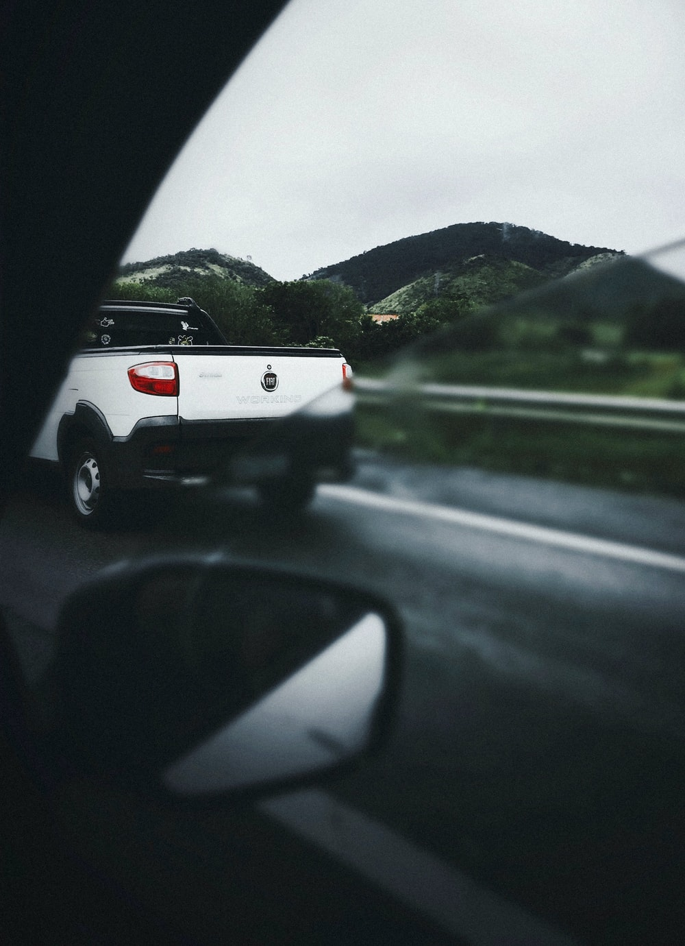 white pickup truck travelling on road