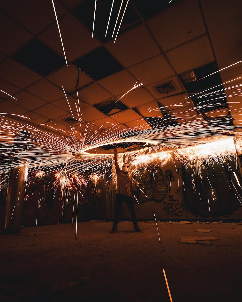 man holding steel wool in room