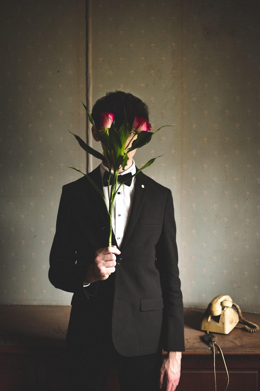 man holding red rose