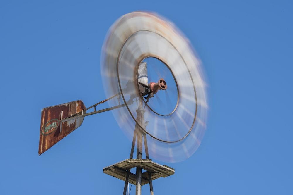 brown wind mill under blue sky