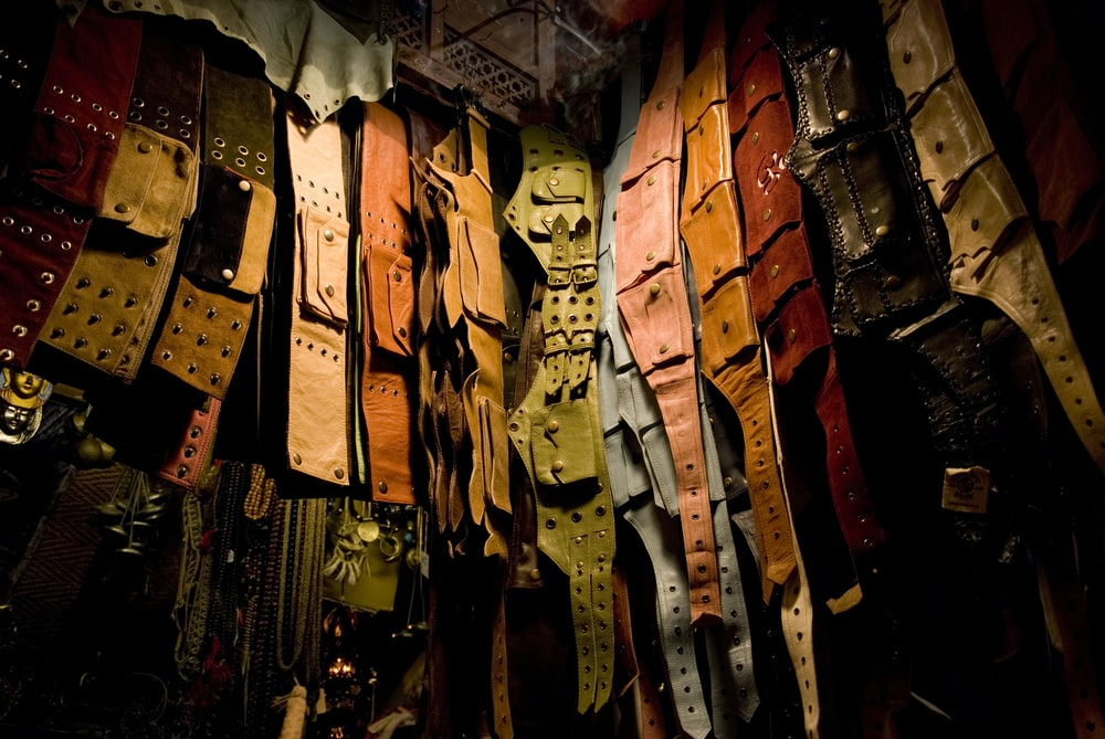 assorted-color leather belt lot being displayed