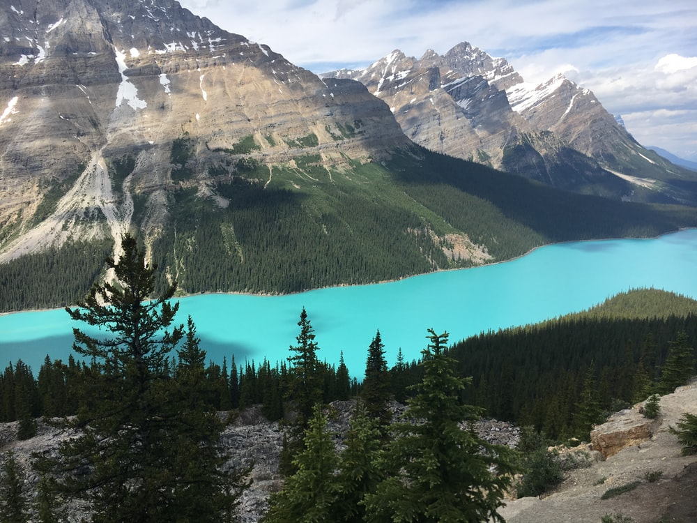 blue river surrounding mountains