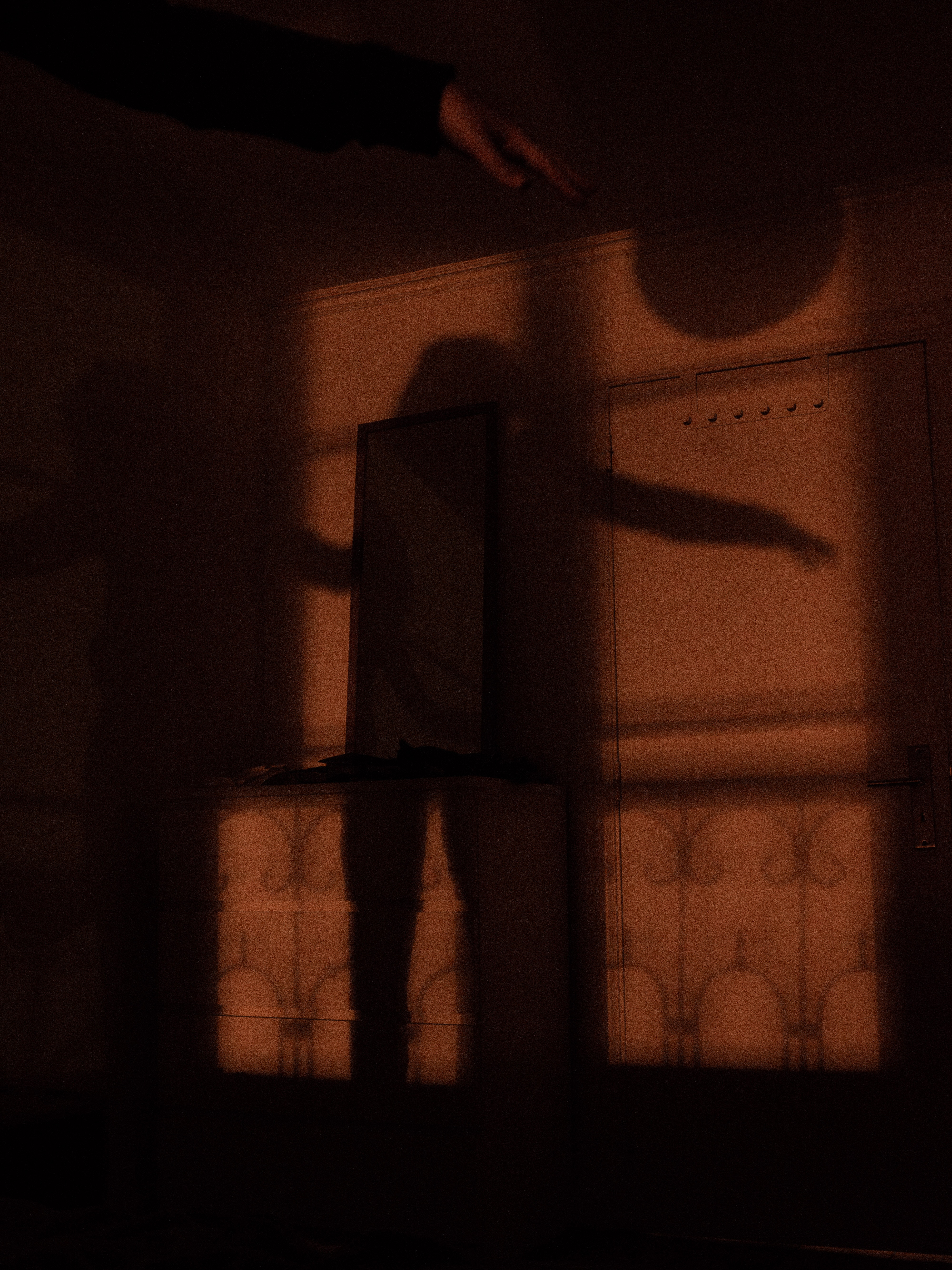 person's shadow cast on wall