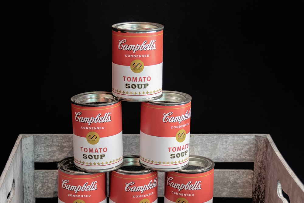 pile up of Campbell's tomato soup cans