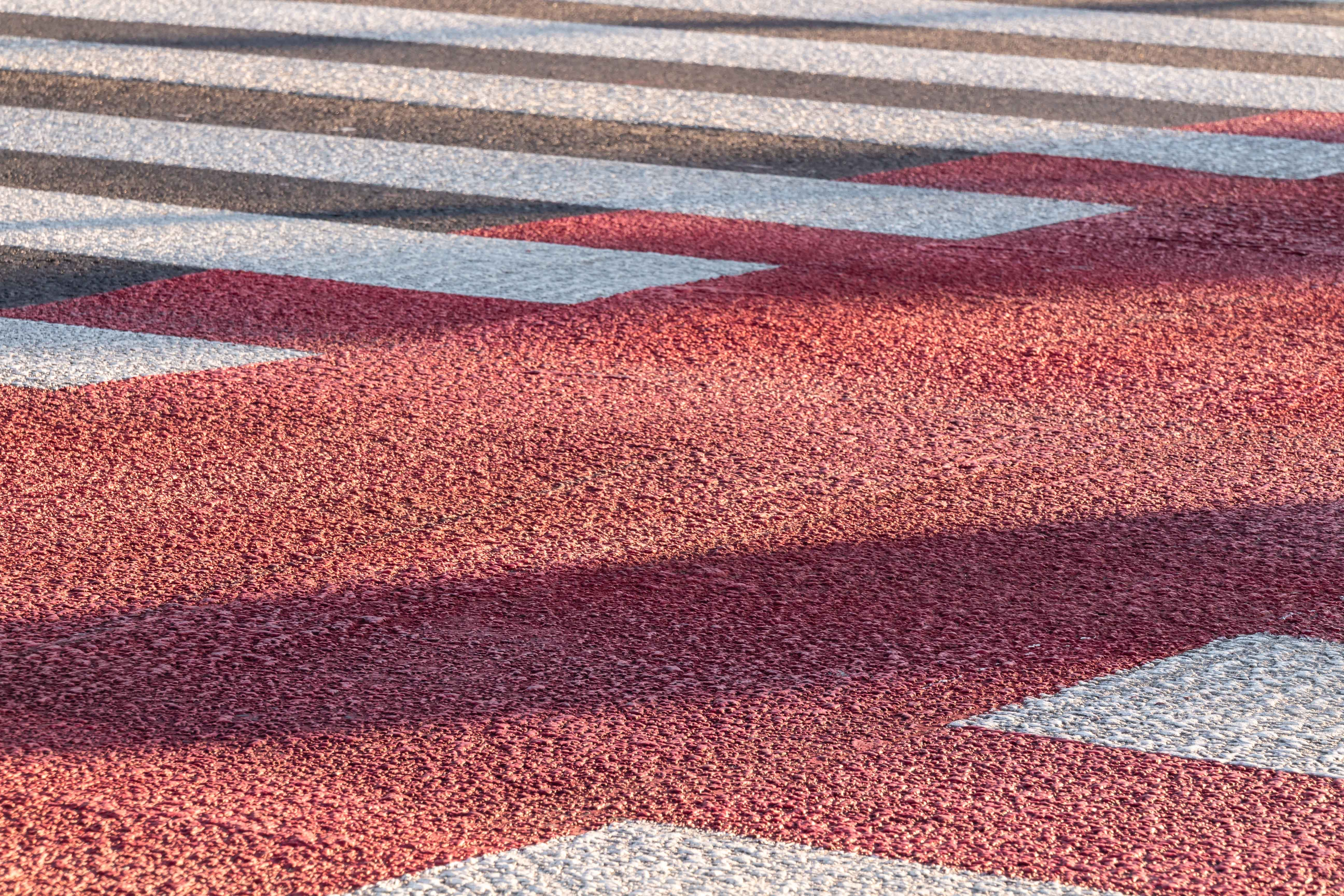 red and gray concrete roadway