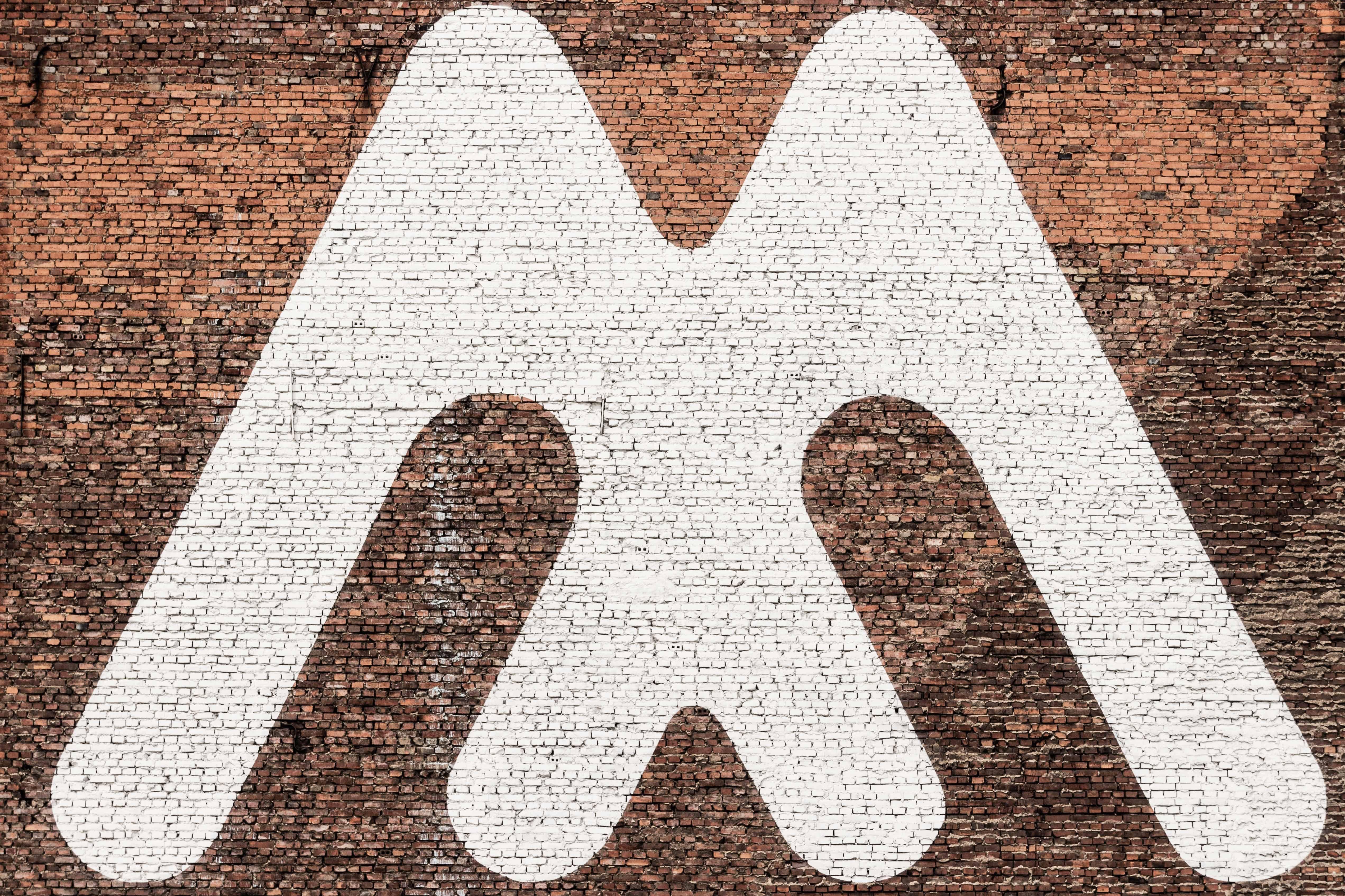 white M logo