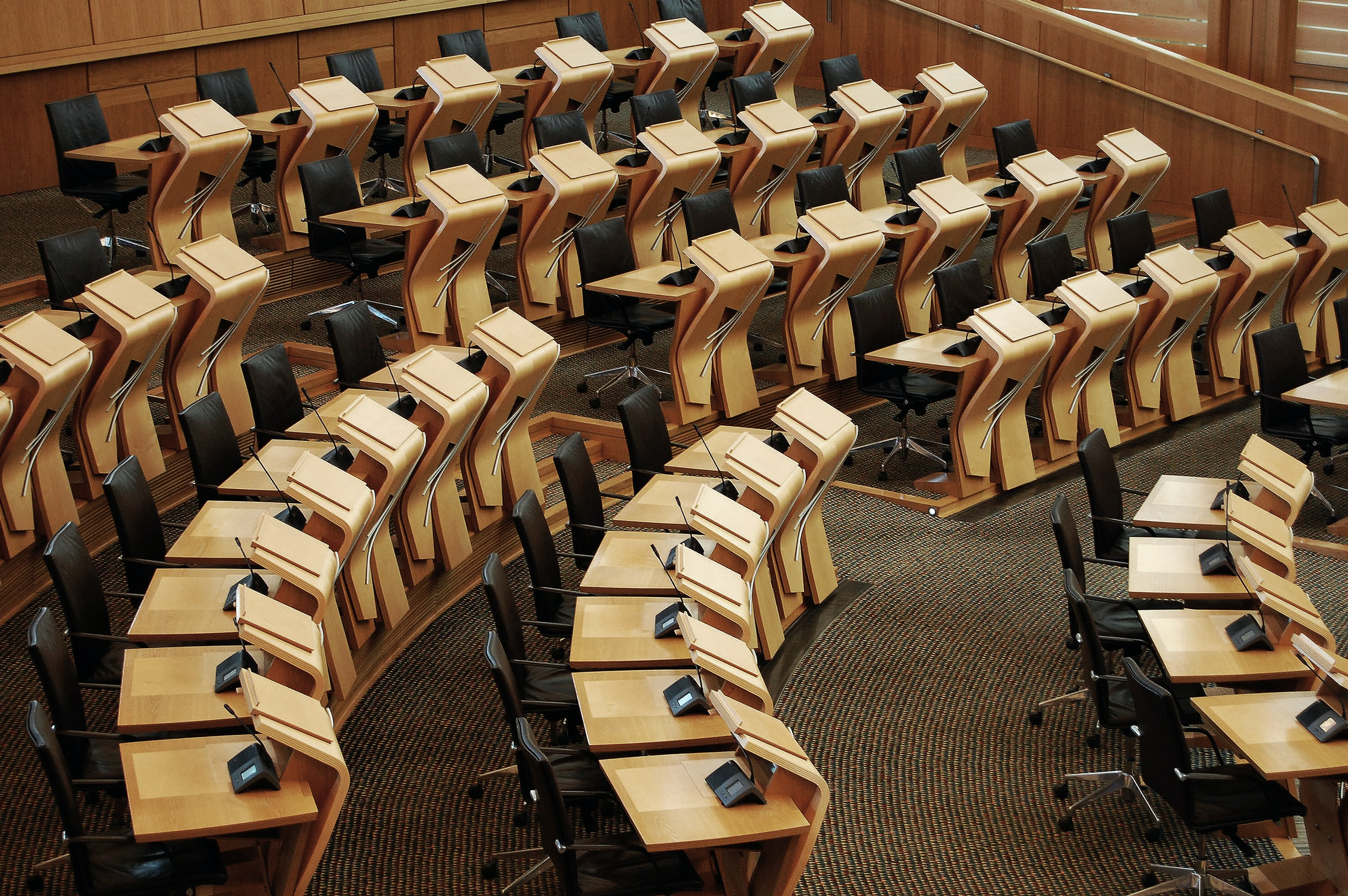 well-arranged rolling chairs and desks