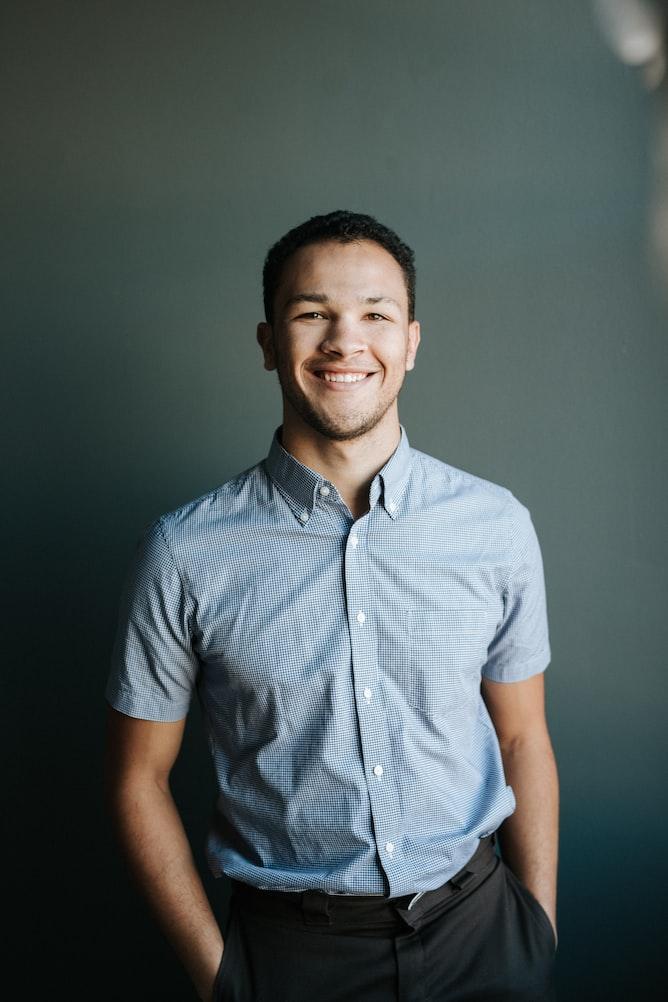 a men smiling at the camera