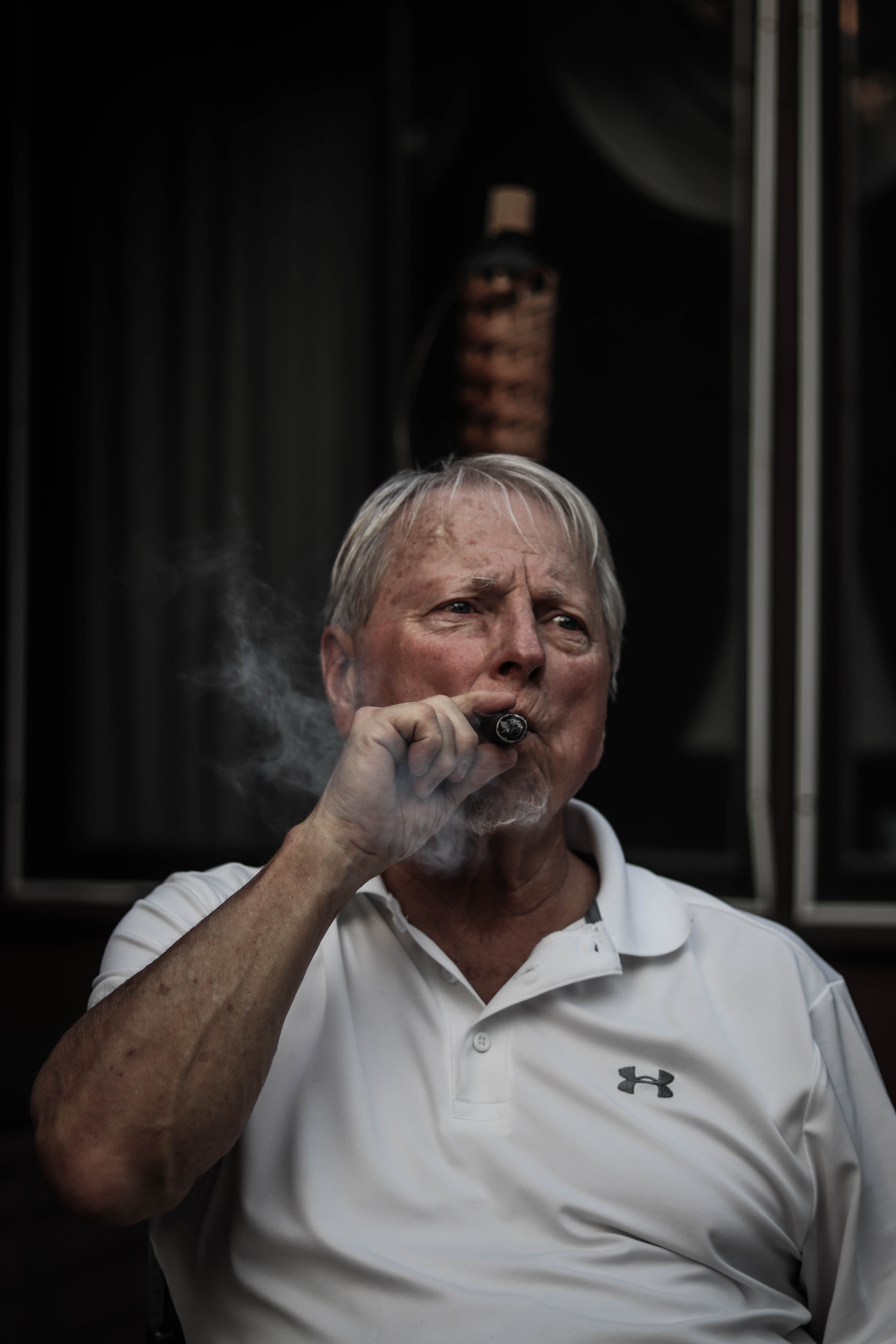 selective focus photography of man using tobacco