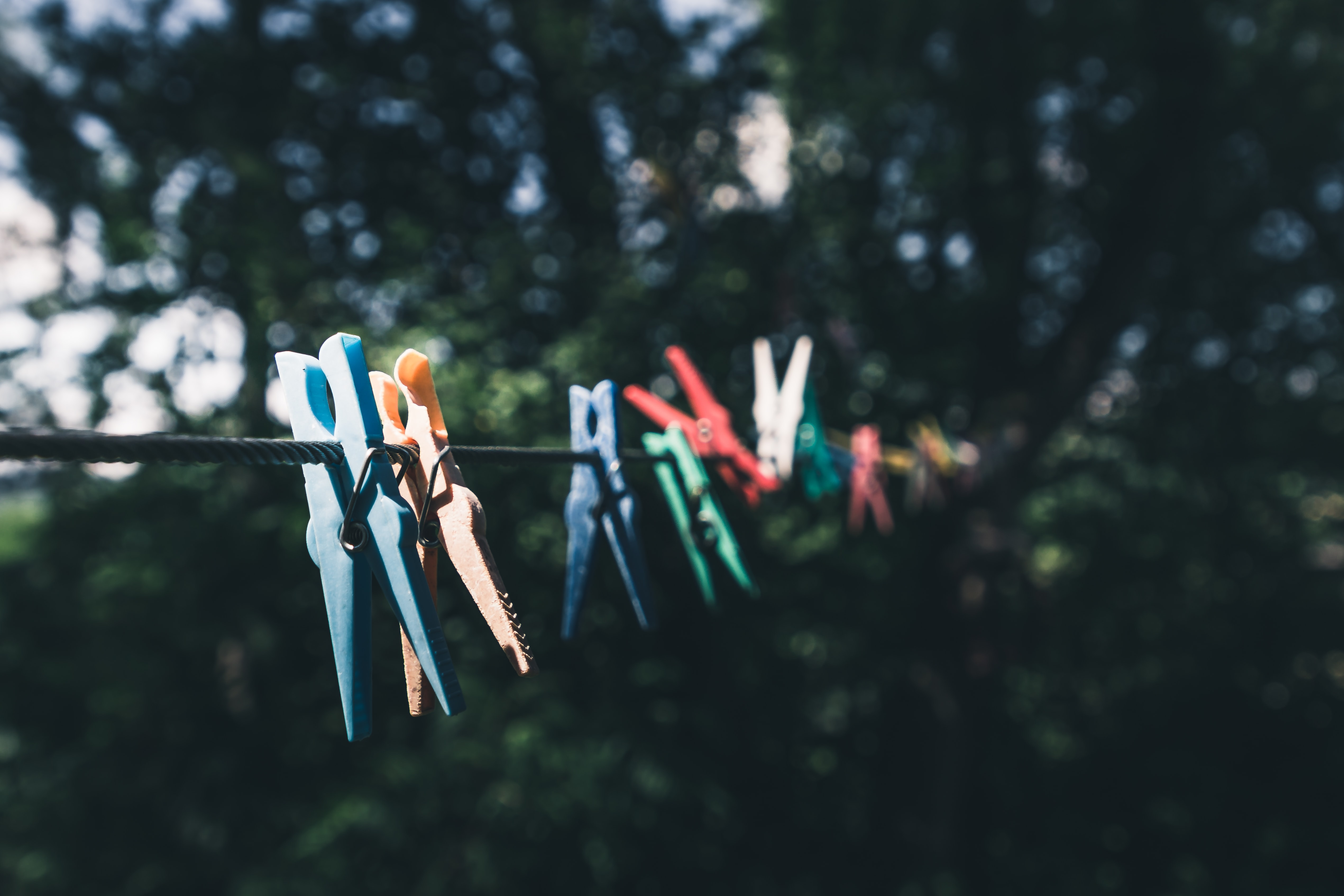 clothespins on black rope