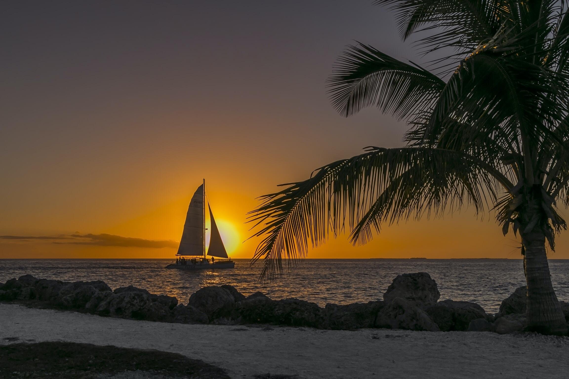sailboat at sea near seashore