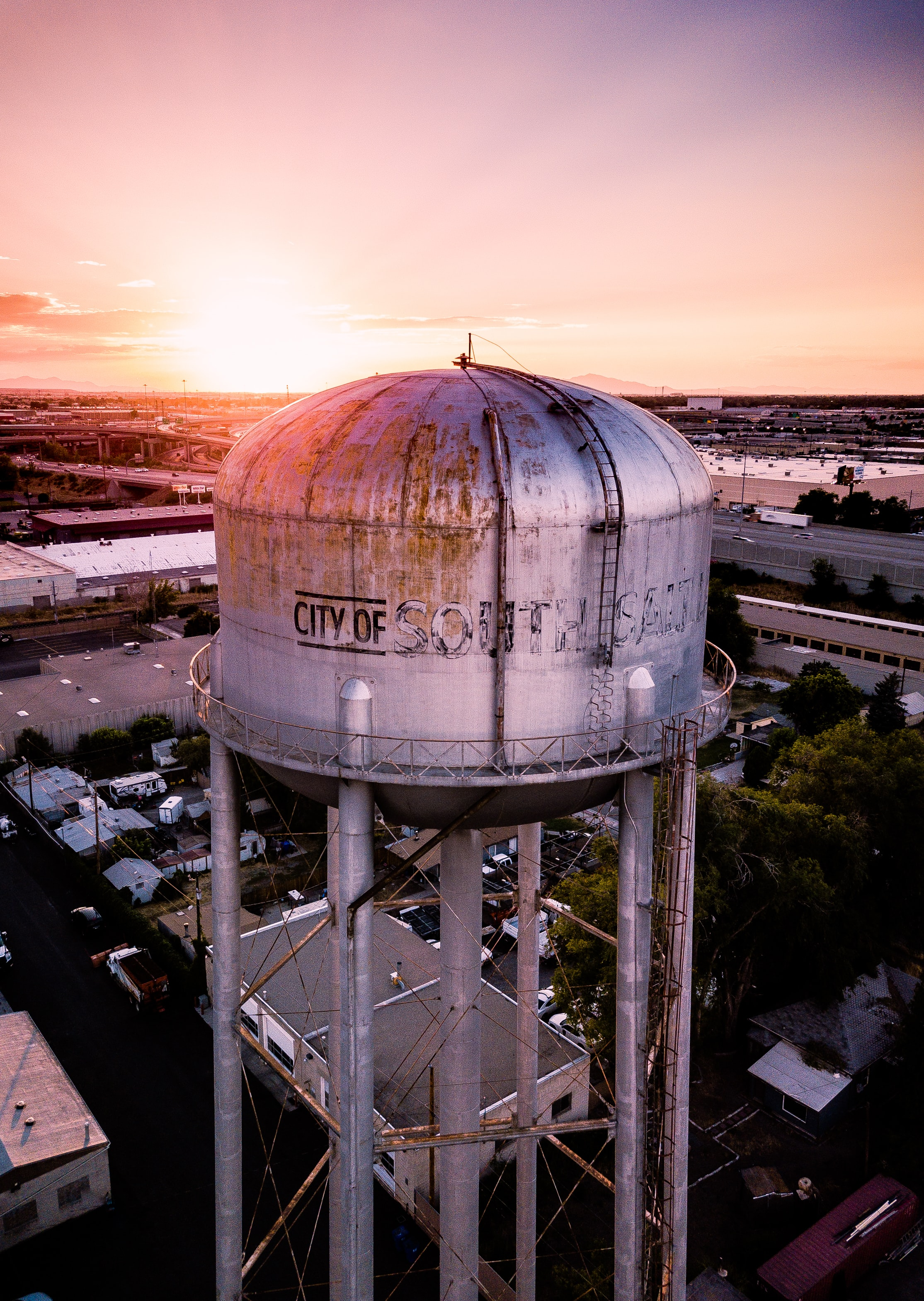 aerial photography of gray water tower tank at golden hour