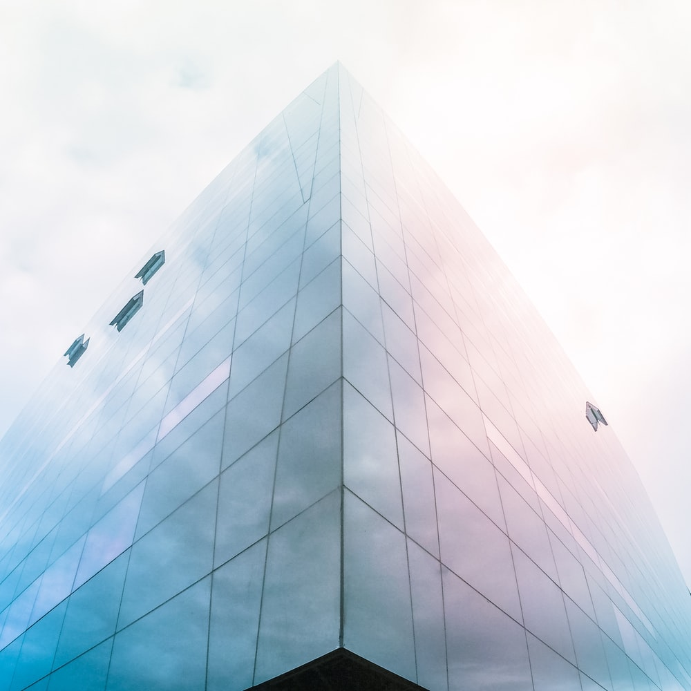 architectural photography of blue glass building