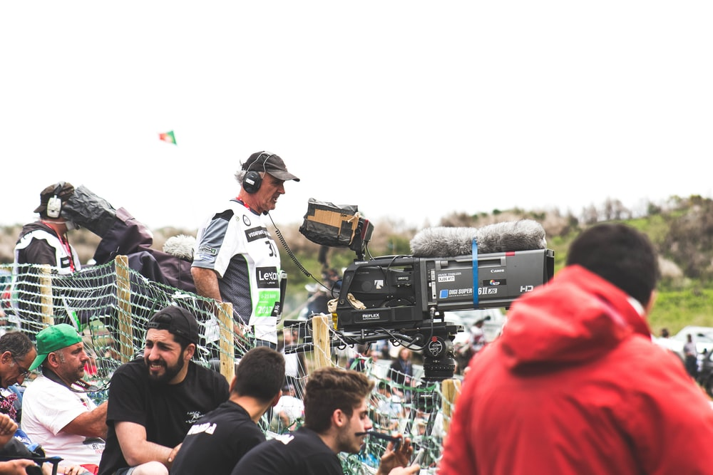 man standing near black and gray video camera
