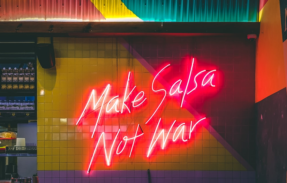 make salsa not war LED signage turned-on
