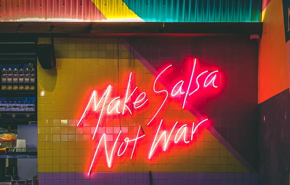 make salsa not war LED signage turned-on
