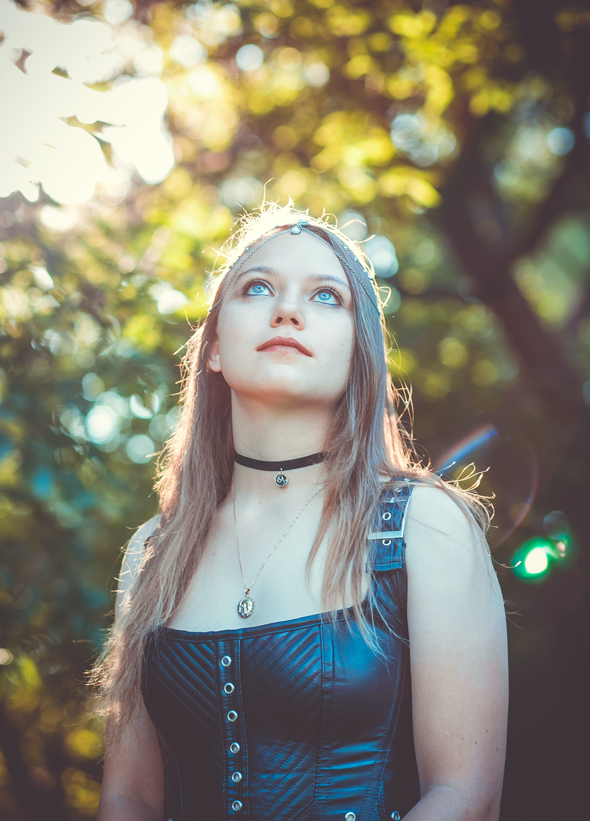 shallow focus photography of woman in black leather sleeveless top