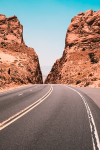 road in between on rock formation