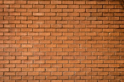 closeup photography of brown brick wall wall zoom background