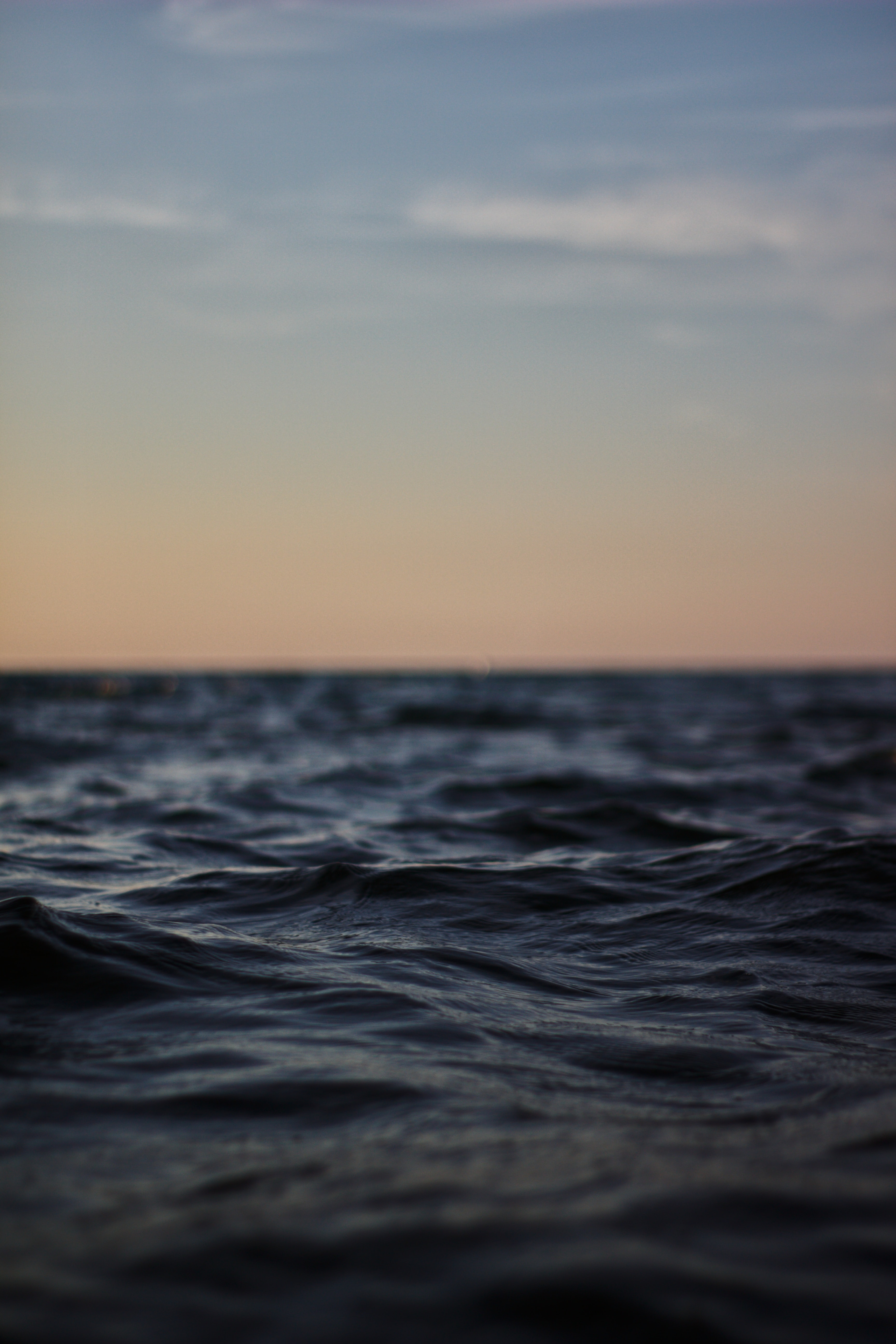 shallow focus photography of body of water