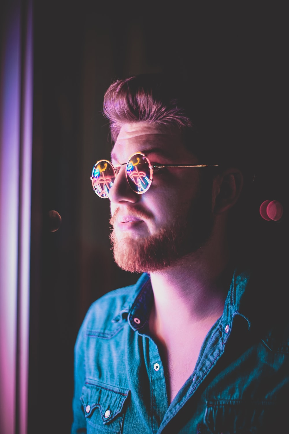 man wearing sunglasses at dim lighted room