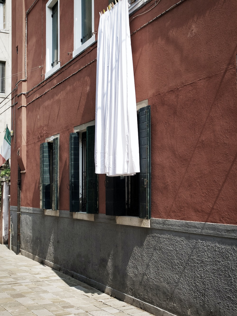 white textile hanging at the building