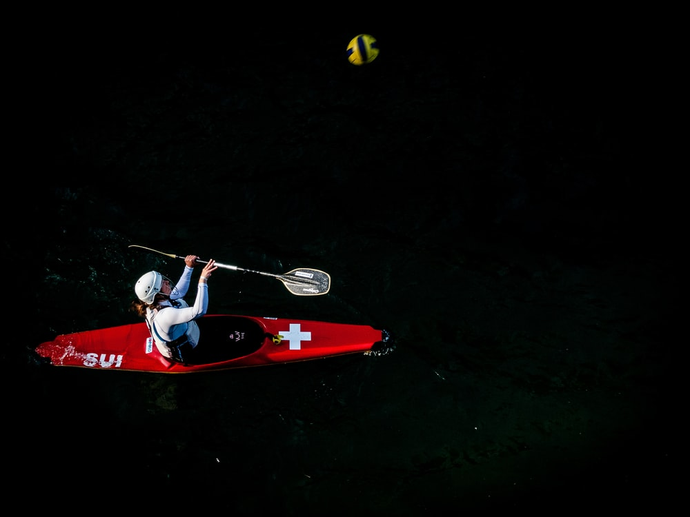 person on boat with paddle