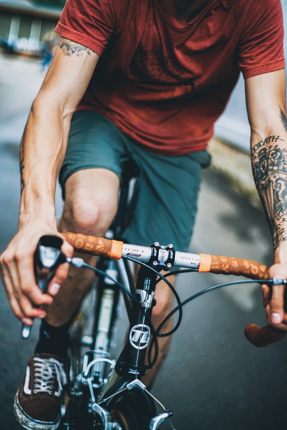 man riding black and gray bicycle photo