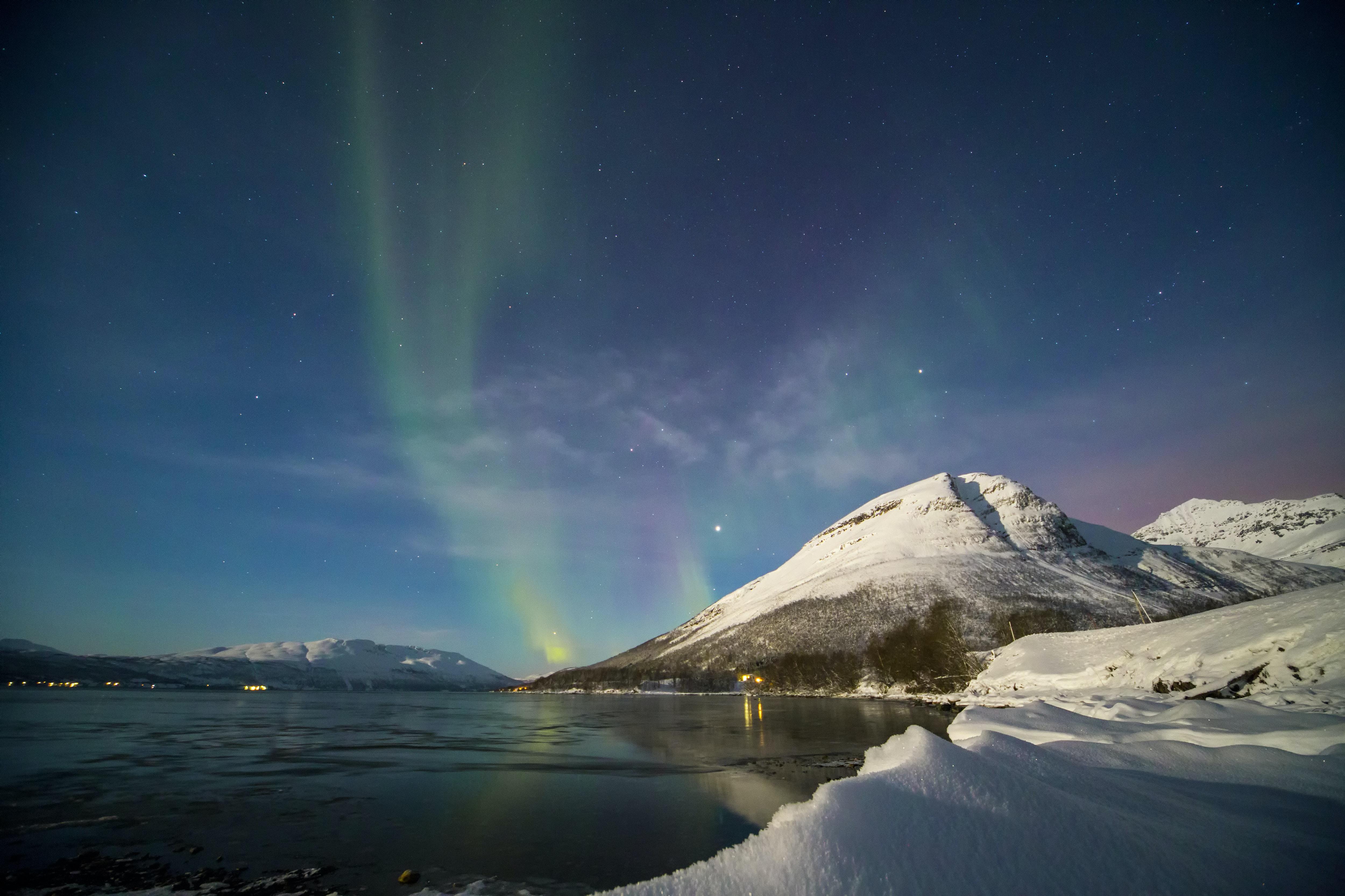 Aurora Borealis on body of water during daytime