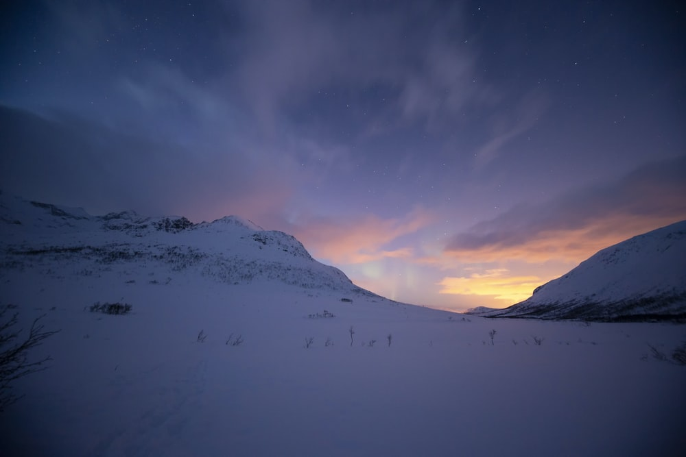 snowy mountain during golden hour photography