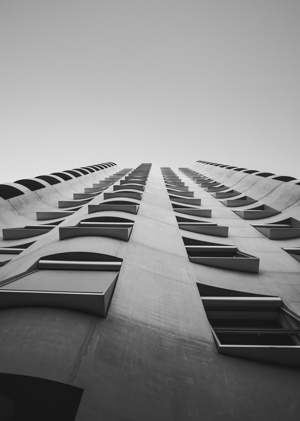 low-angle photography of gray concrete building