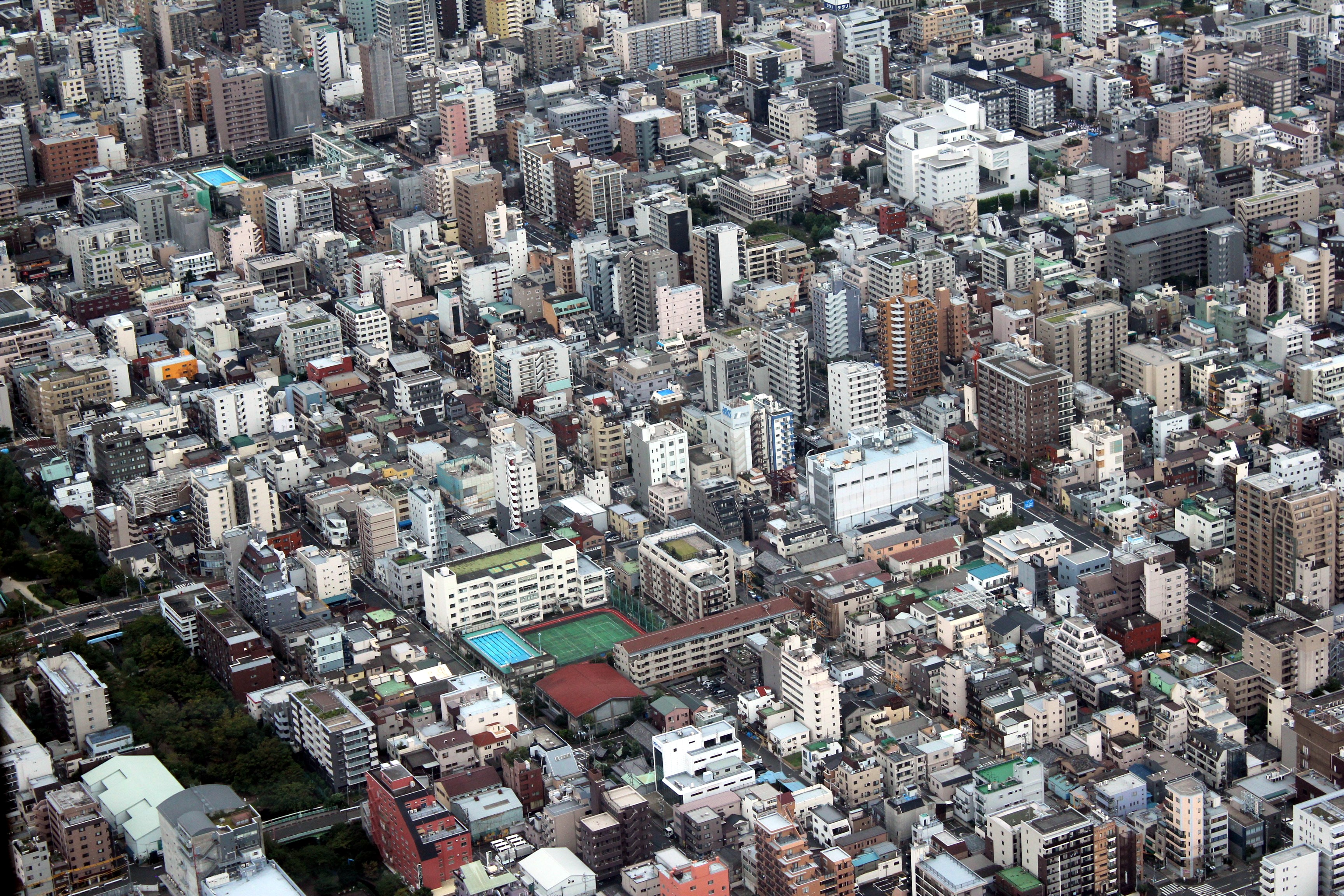 aerial photo of assorted-color concrete city high rise buildings