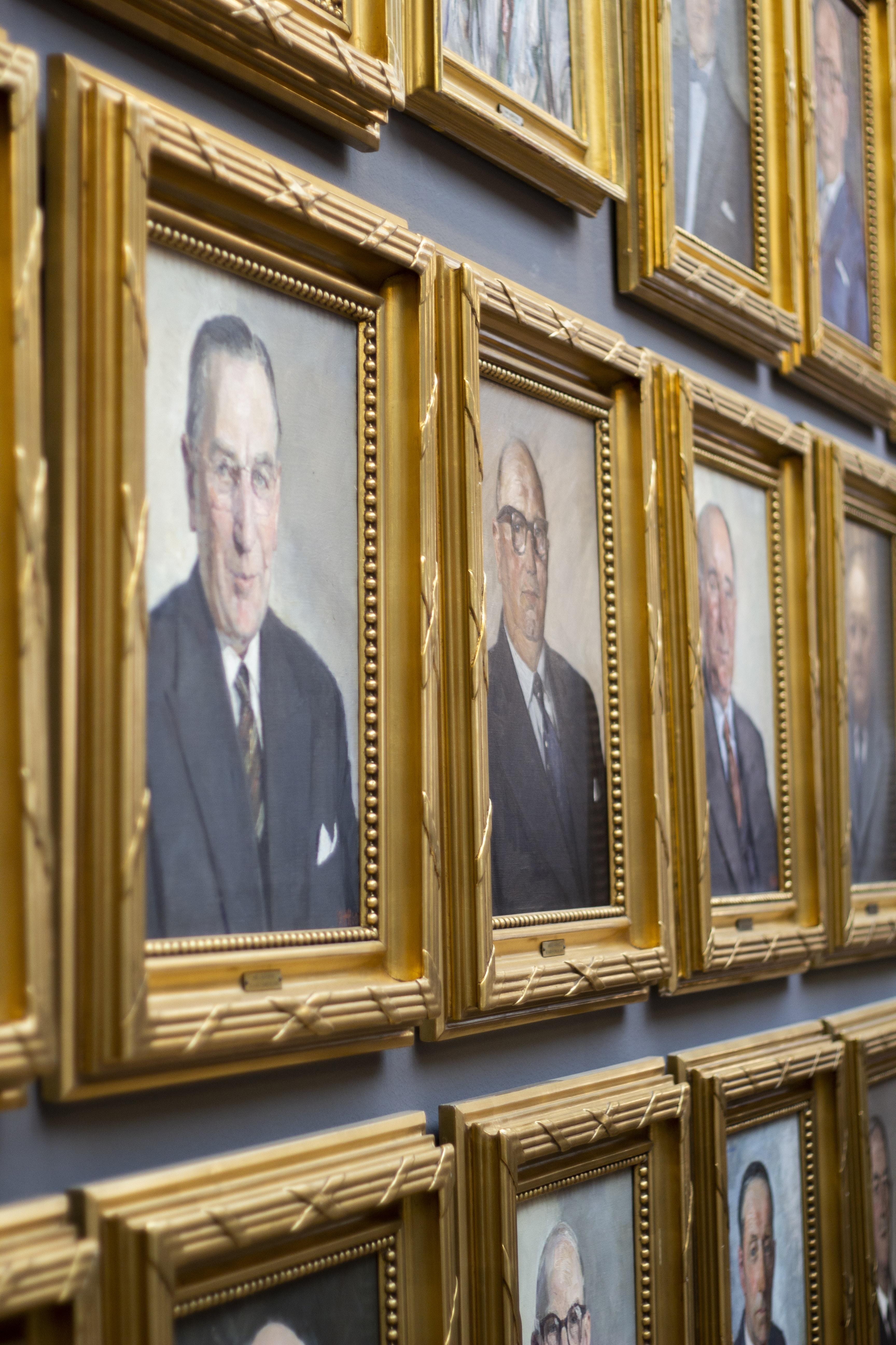 brown wooden photo frames of men