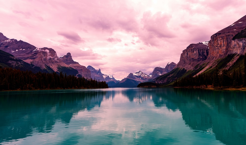 landscape photography of body of water overlooking mountain range