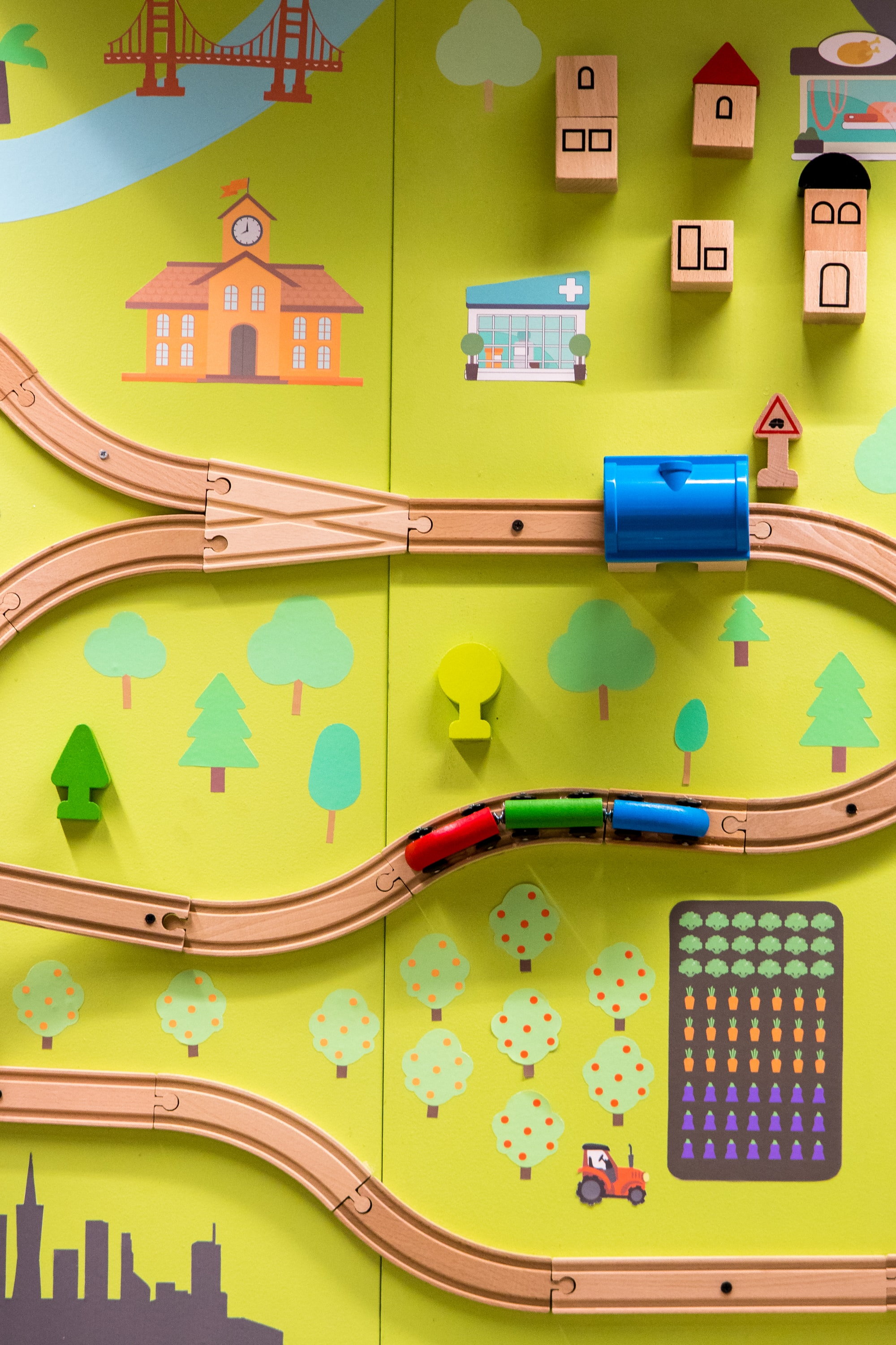 Image of a child's wooden train set.