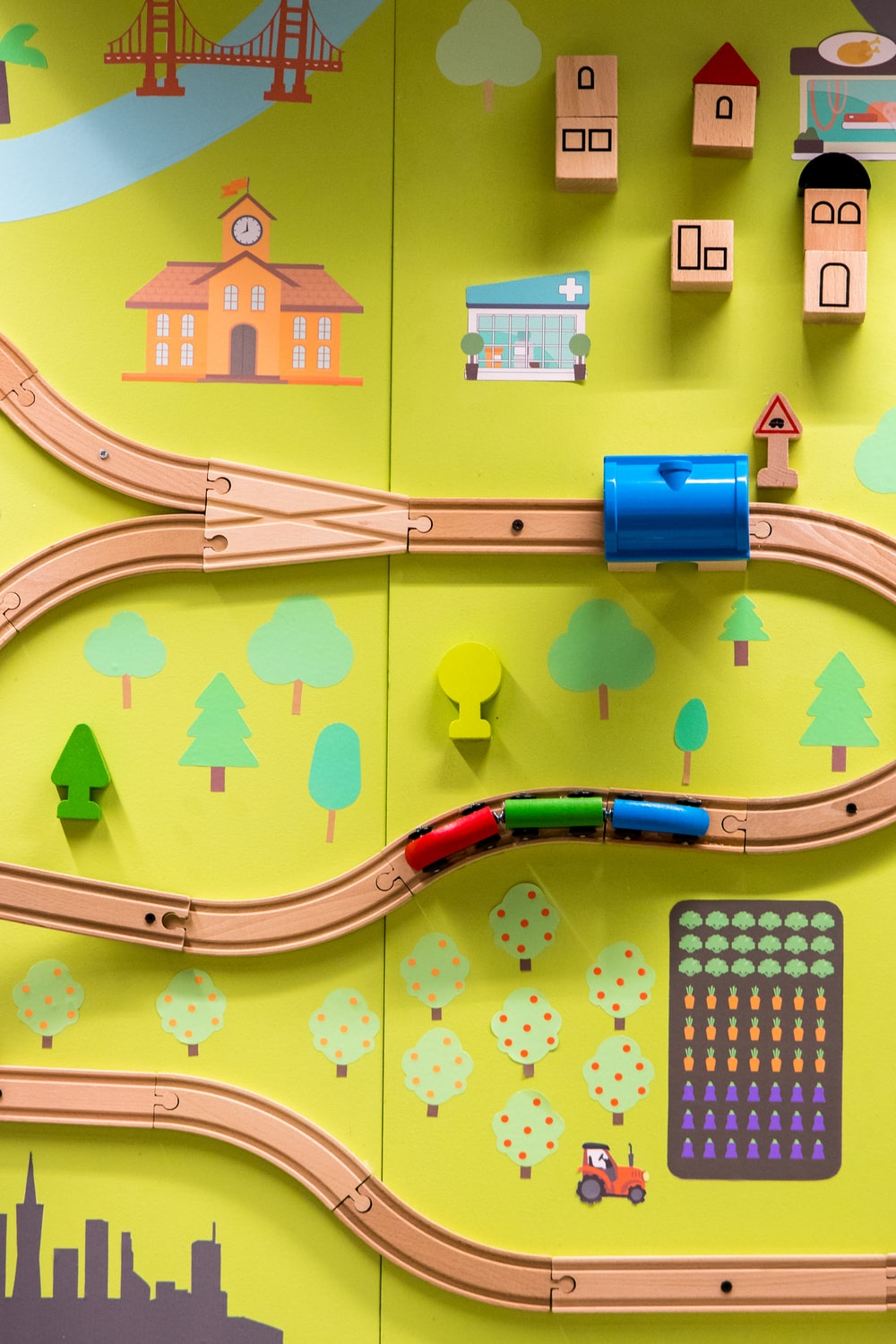 brown and multicolored train toy set