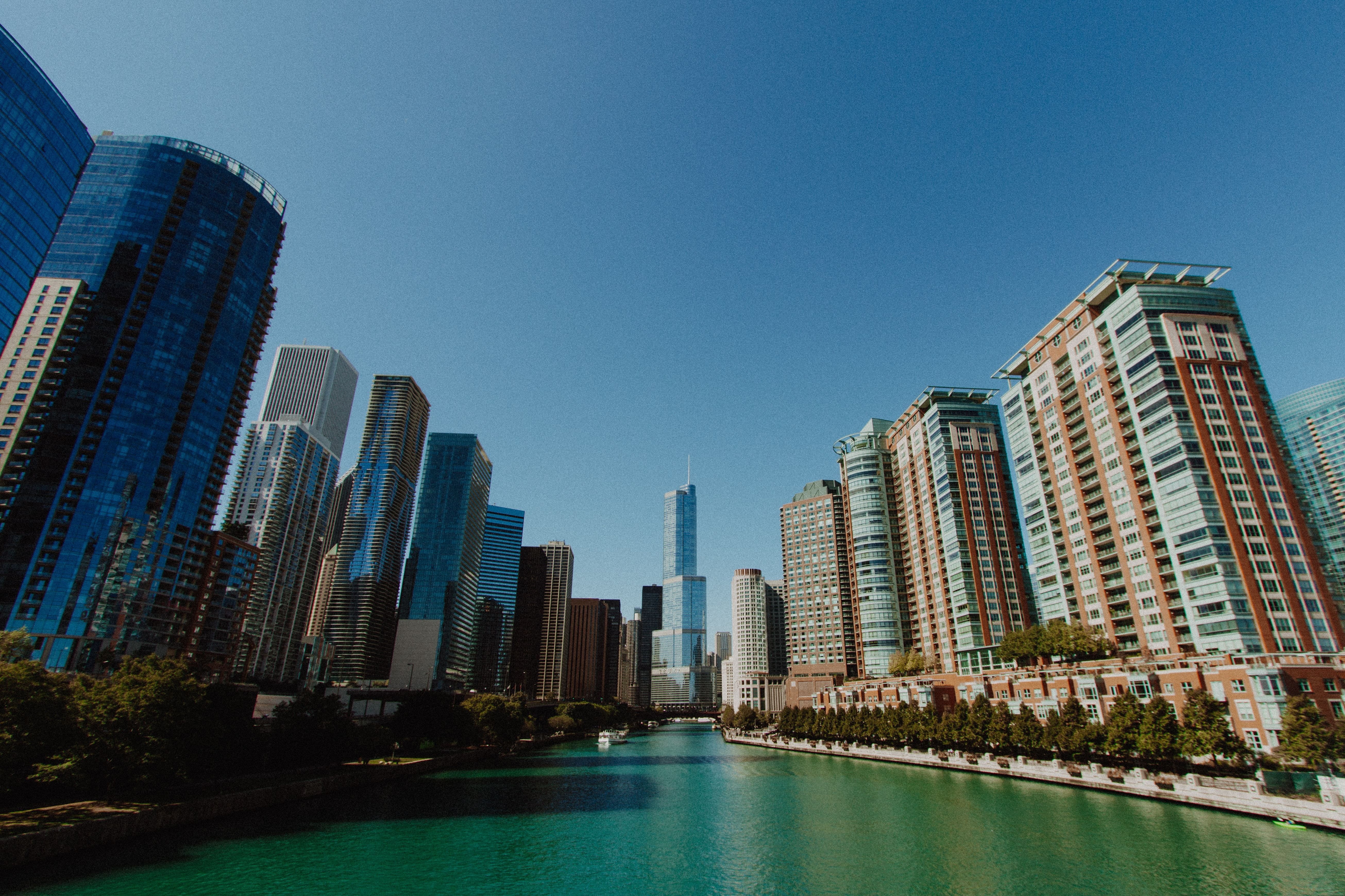 river flowing between high-rise buildings during daytime photo