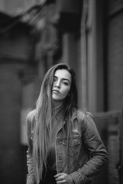 grey scale photo of woman in jacket