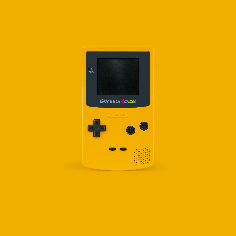 White And Black Nintendo Game Boy Color On Yellow Surface Photo Free Retro Image On Unsplash