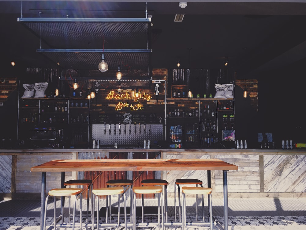 brown bar counter with stools