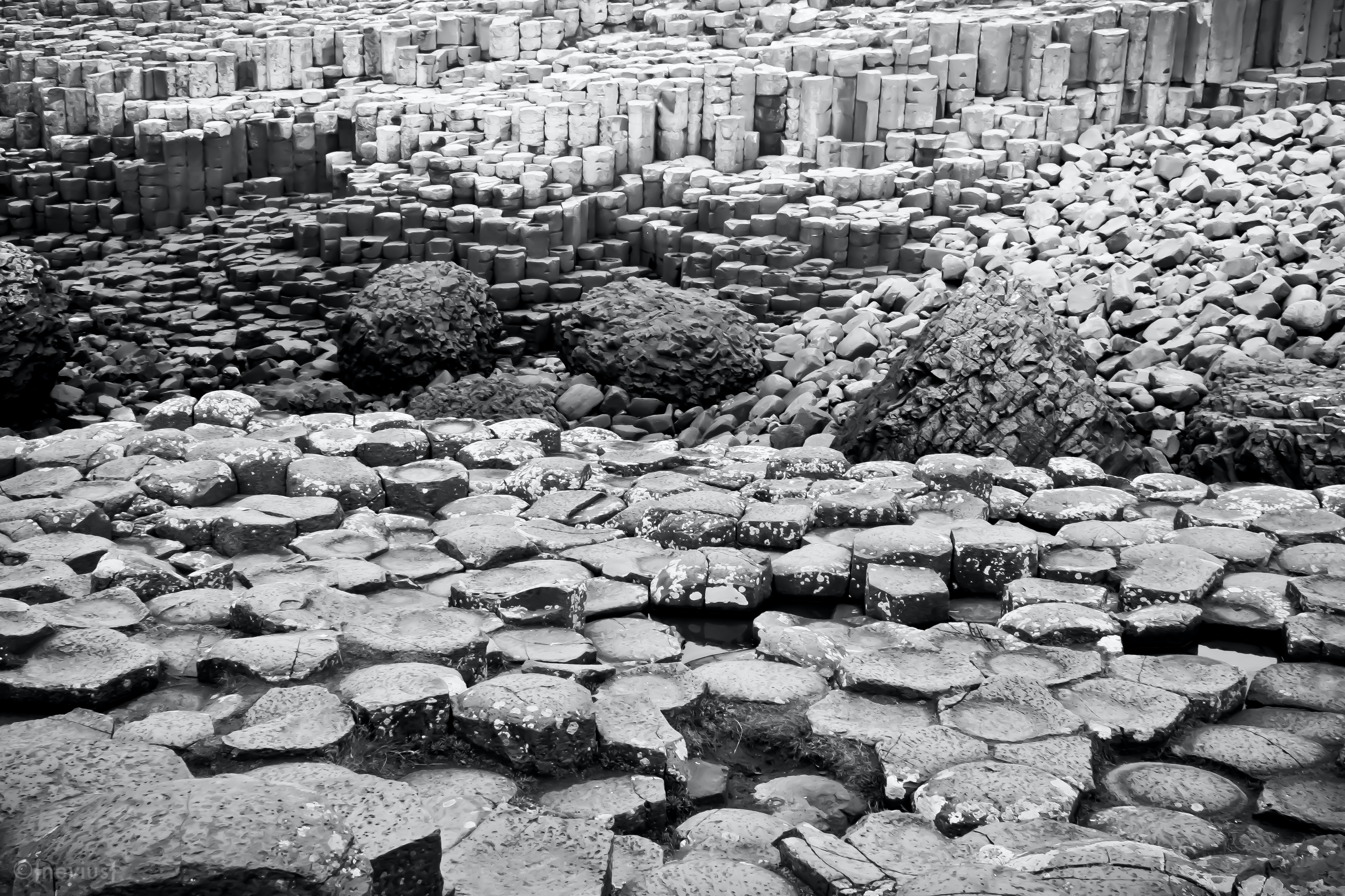 grayscale photography of stone formation
